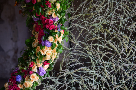 Wreath of flowers, leaves with dry grass on grunge background. Autumn, summer, spring, midsummer season. Holiday celebration, preparation concept. Decoration, arrangement, garland Stock Photo