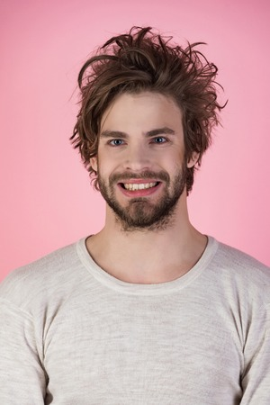 Sleepy man with beard on pink background. Man with disheveled hair in underwear. Insomnia, energy, single with uncombed hair. Morning wake up, everyday life. Barber and hairdresser, male fashion. Stock Photo