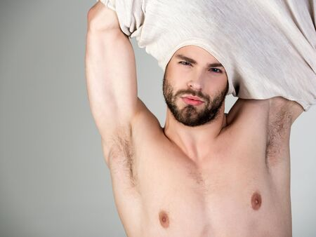 Sleepy man undress on grey background. Insomnia, energy, single with uncombed hair. Morning wake up, everyday life. Man with disheveled hair in underwear. Barber and hairdresser, male fashion.