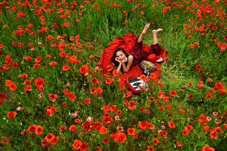 Drug, narcotics, opium, woman with typewriter, camera, book. drug and narcotics, woman in poppy flower Stock Photo