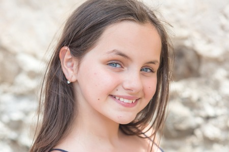 Youth, skincare, health. Girl with long hair smile on sunny day, beauty. Little child smiling with cute face outdoor. Kid beauty, look, hairstyle. Happy child, childhood concept. Archivio Fotografico