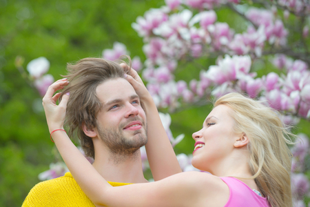 Sensual woman and man in magnolia bloom. Stock Photo