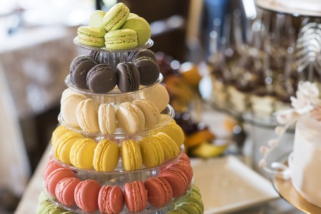 Dessert, food, snack. Macaroons on cake stand. French cuisine, menu, recipes. Macaroon cookies for birthday, anniversary, mothers day celebration.