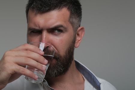 Bearded man drink water. Thirst, dryness, drought. Water consumption concept. Health, diet, healthy dieting.