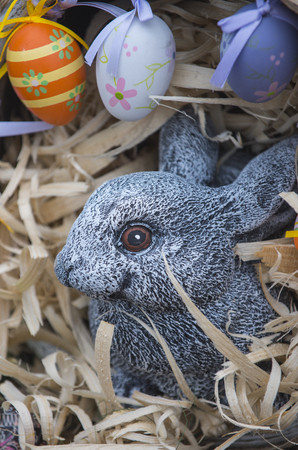 Easter rabbit with easter eggs. Easter symbol of spring, fertility, abundance and new life.