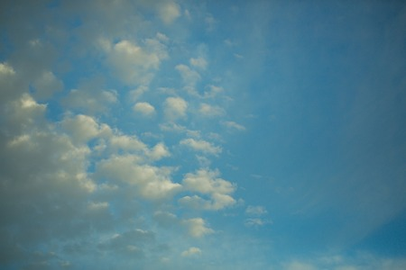 Meteorology, weather, climate. Blue sky with white clouds. Nature, environment, ecology. Cloudscape, condensation, cumulus. Freedom, wanderlust, vacation concept, copy space Stock fotó