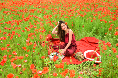 Poppy, Remembrance or Anzac Day. Opium poppy, agile business, ecology. Journalism and writing, summer. Woman writer in poppy flower field. Drug, narcotics, opium, woman with typewriter, camera, book. Reklamní fotografie - 96233545