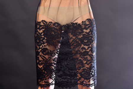 Folk look. erotic games, handmade, design. Fashion and beauty, look, sexy girl. black lace skirt on sexy slim female legs.