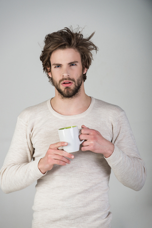 Man with disheveled hair drink mulled wine. Stock fotó