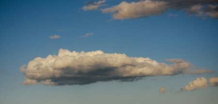 Cloudscape, weather, climate. Sky with clouds on blue background. Air, atmosphere, ozone. Nature, environment, ecology.