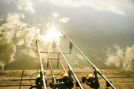 Carp fishing rods, fishing line, freshwater, water reflection Stock Photo
