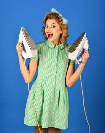 Retro woman ironing clothes, gender inequality. retro style, woman hold iron on blue background