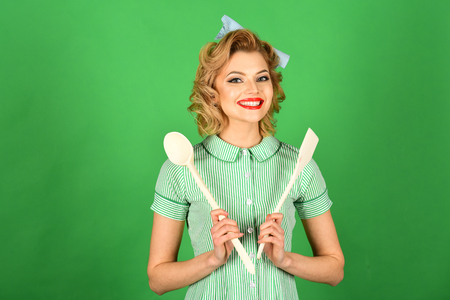 Housekeeper with kitchen utensil, household. Retro woman cooking, gender inequality. Everyday life, housework. Chef cooking, wife. Pinup woman cook hold kitchenware, retro style, maid.
