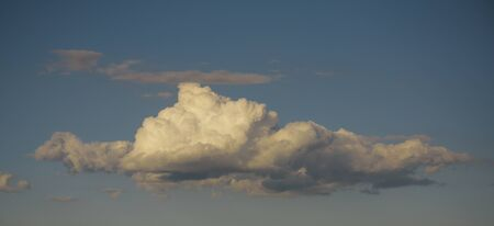Sky with clouds on blue background. Air, atmosphere, ozone. Cloudscape, weather, climate. Nature, environment, ecology.