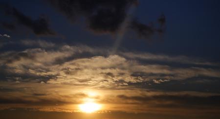 Sunset sun on cloudy sky background. Sundown, evening, dusk. Sunshine, atmosphere, nature. Standard-Bild - 96675189
