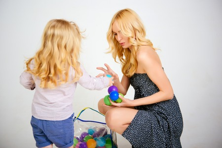 Happy family play with toy balls. mother and child, relatives. Mothers day, family values, trust, childhood. mother and son. Love, happiness, parenting.