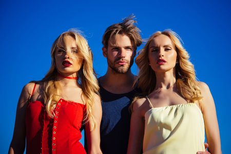 Charming man in between two beautiful blondes Stock Photo