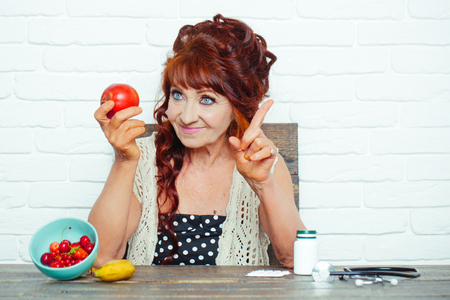 Senior woman smile with apple in hand