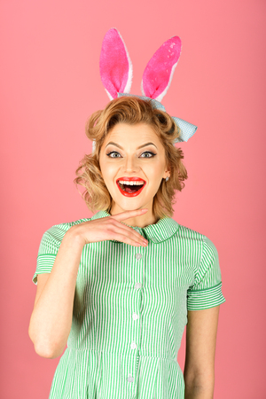 Beauty, fashion, cosmetics, vintage style. Retro woman in bunny ears, easter. Easter, makeup, pinup party, girl in rabbit ears. Pinup woman, vintage, look. Sexy blond girl with retro makeup, playboy. Stock Photo