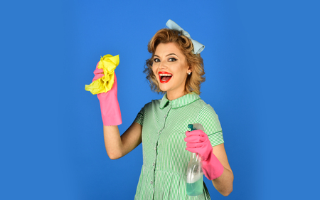 Housekeeper in uniform with clean spray, duster. housekeeper or happy wife cleaning with soap bottle and duster Stock Photo