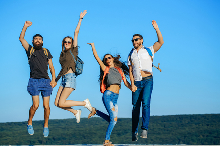 Fun group of young people jumping outdoor. Stock Photo