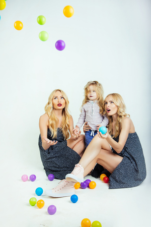 mother and son, happiness. Mothers day, family values, trust, childhood. Happy family play with toy balls. Love, happiness, parenting. Child small boy and twins women, relatives. Stock Photo
