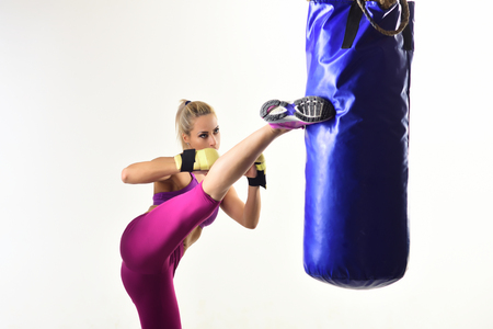 Woman winner athlete, kick boxing. Sport coach in gym with punching bag. Knockout, energy, sport success. Boxer girl workout, healthy fitness. Woman boxing in sportswear gloves at punching bag. mma Stockfoto
