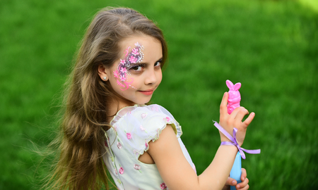 Little girl with long hair holding bubble blower. little girl with bubble blower and fashionable makeup, long beautiful hair