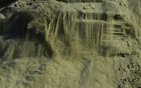 Nature, geology, ecology, environment. Sand mass in sandpit. Sand quarry in open pit mine. Sandy texture background. Mineral, building material, construction.