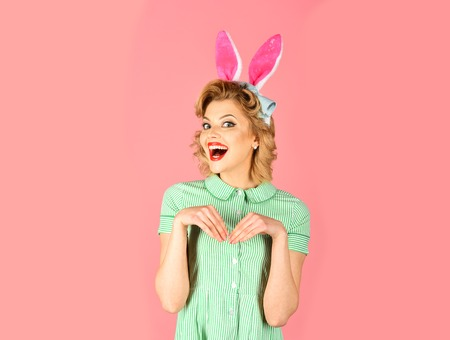 Sexy blond girl with retro makeup, playboy. Easter, makeup, pinup party, girl in rabbit ears. Pinup woman, vintage, look. Retro woman in bunny ears, easter. Beauty, fashion, cosmetics, vintage style.