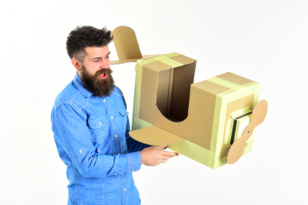 Pilot travel, airdrome, dream. Bearded man father hold cardboard plane isolated on white. Air mail delivery, aircraft construction. Man engineer, pilot school, innovation. Dream, business, adventure.