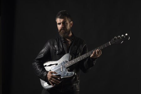 Music, Hipster play musical instrument, concert. Hipster with beard with electric guitar, music.