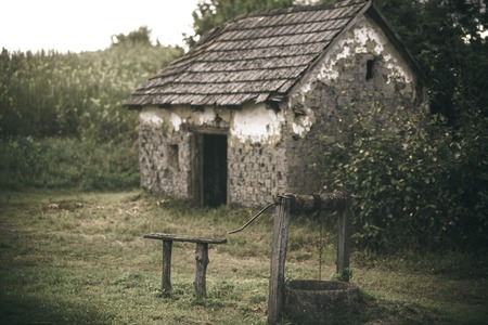 House barrack with old well in yard.