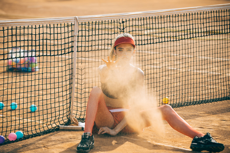 Sport woman throw sand at tennis court. Sport, tennis, activity, lifestyle concept.