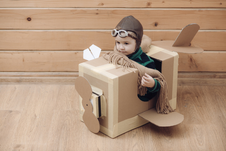 Kid Travel on Toy Airplane, Child Sitting, Vacation, Fly in Plane, Baby playing Pilot