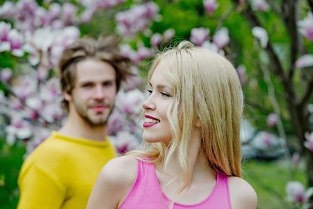 Sensual woman and man in magnolia bloom. Banco de Imagens