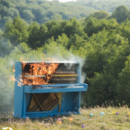 Rock concert, jazz, fireplace, destruction. rock concert and piano destruction Stock Photo