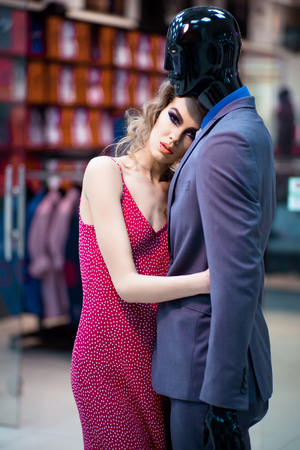 Woman hugging mannequin, perfect man dream concept