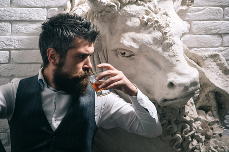 Art exposition, antique. antique art and bearded man with whiskey