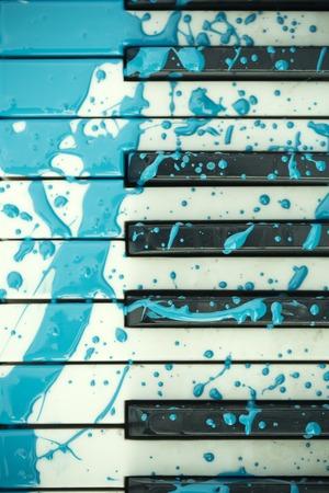 Piano keayboard in blue paint stain, keyboard.