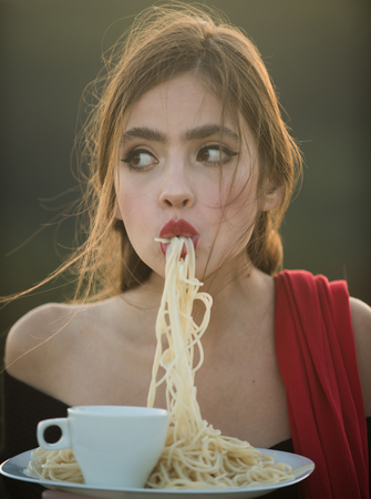 Hunger, appetite, recipe. hunger and appetite of young woman with red lips eating dinner