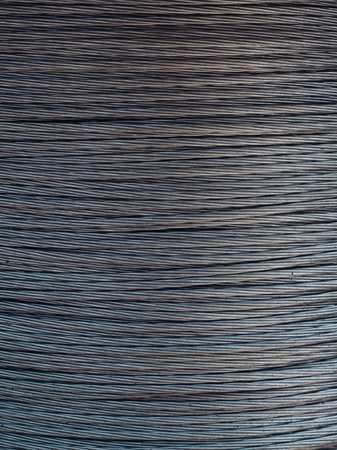 Steel or metal rope, wire. Building material concept. Beautiful metallic background, texture of rope. Coil of cable, hawser, steel rope.