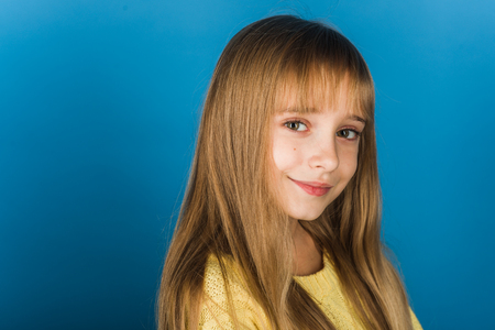 Beauty or kid fashion with cosmetics and healthy hair. Stylish girl with pretty face. Little girl with long hair. Hairdresser, skincare, casual style, denim. Fashion model and beauty look. Foto de archivo