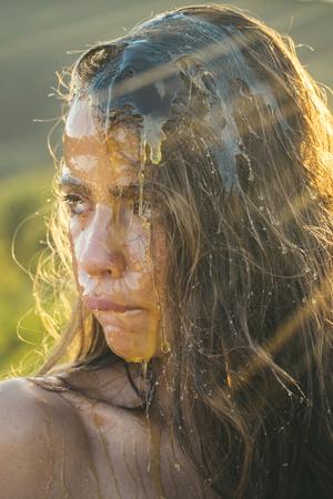Closeup of a female cheek with honey. Фото со стока