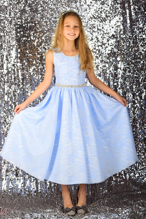 Fashion model on silver background, beauty. fashion model of small girl