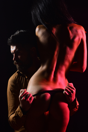 Love, relations, couple in love, buttocks. Man, woman with naked body, valentines day. Sexy body, family couple, massage. Couple in love with sexy body, relax. Erotic games, desire, orgasm, foreplay. Stockfoto