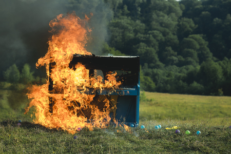 destruction, rock concert, jazz, fireplace. destruction of old piano in fire