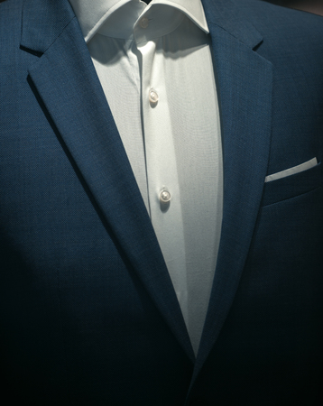 Part of formal male garment, close up. Classic jacket with white shirt made out of high quality textile, luxury clothes. Official style of clothing, dress code. Business clothing. Menswear concept. Foto de archivo - 99390597
