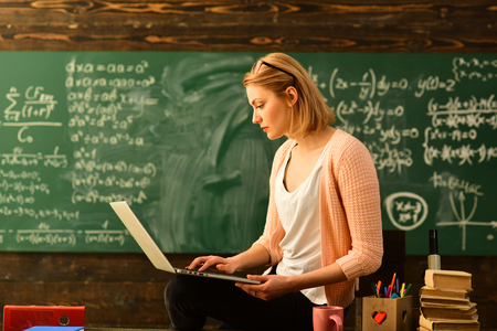 Teacher in glasses reading reports of talented students correcting mistakes, Tutor needs to be enthusiastic and needs to like his subject, Student studying online courses with computer,