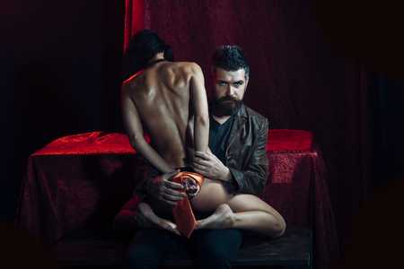 Dominance and submission, couple. Love, man and woman with tied hand. Couple in love, bdsm, bearded man and naked girl. Erotic games, sex, orgasm, girl and man. Sexy woman with tied hands, buttocks. Фото со стока - 99892659